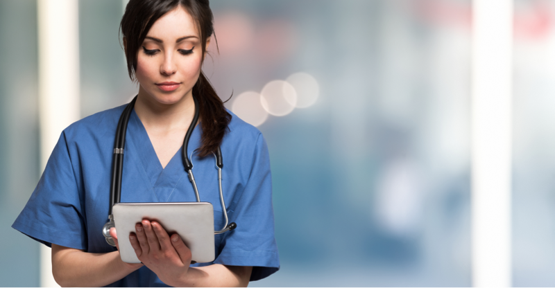 Female nurse using mobile tablet